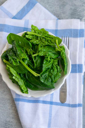 Close up view of raw spinach salad, vegetarian healthy ingredient