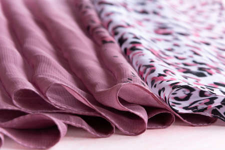Folded colorful cloth. Crop view of fashioned ethnic fabric