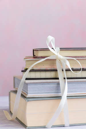 Stack of books tied with a bow