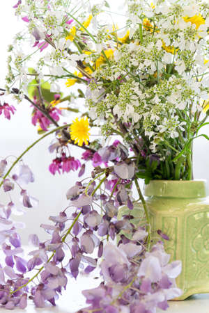Arranging wildflowers, colorful blossom flowers, seasonal floral themes