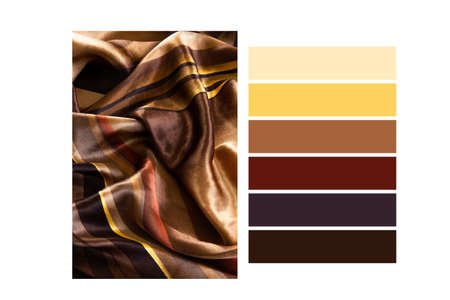 Folded silk golden tone cloth in a colour palette, with complimentary colour swatches