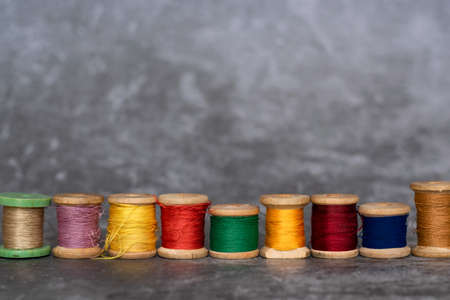 Different colorful cotton mill on gray background Stock Photo