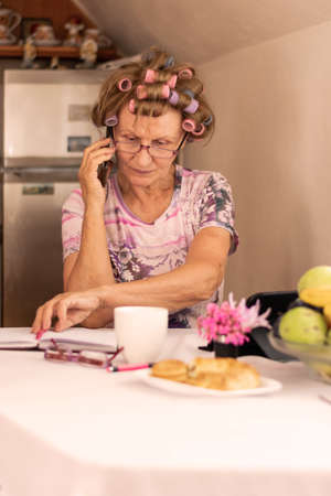 Housewife sitting in kitchen taking care for home budget