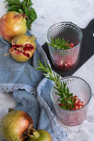 Ripe pomegranate seeds on marble background