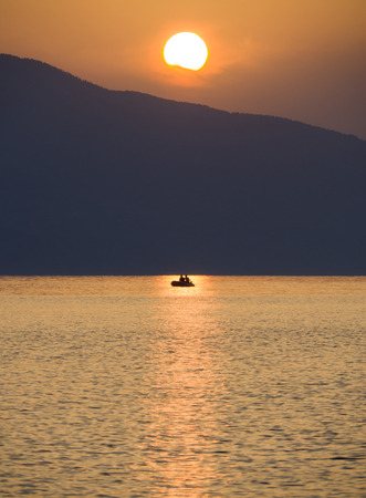 Waves and beautiful sunset on the Greek island Evia (Euboea) in the Aegean Sea Standard-Bild