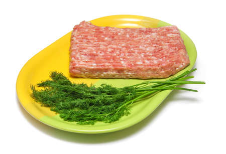 half stuff: minced meat and dill on a plate yellow and green