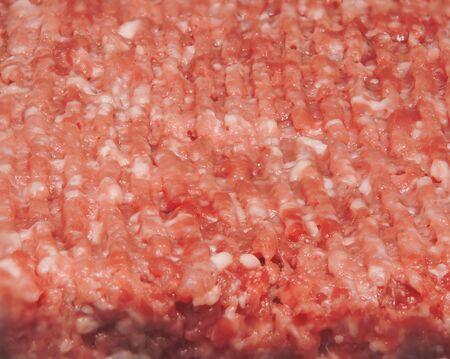 half stuff: red raw ground beef pork closeup background