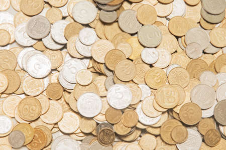 a lot of Ukrainian of coins background photo