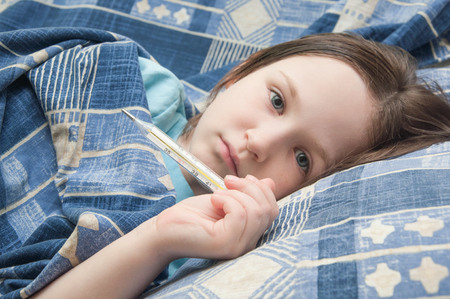 body temperature: baby girl is sick with influenza. body temperature measurement