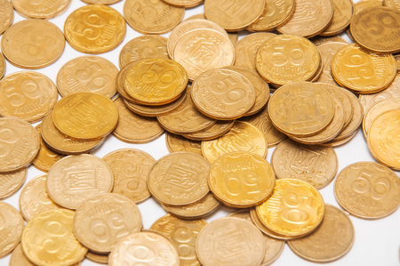 nominal: nominal value of fifty Ukrainian coins on a light background