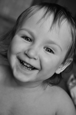 baby facial expressions: little girl portrait black and white close-up