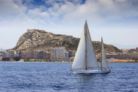 Ketch sailing in Alicante Bay, Spain  photo