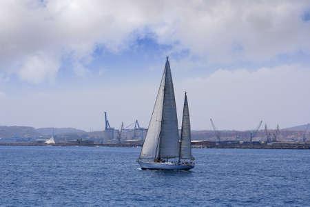 Ketch sailing in Alicante Bay, Spain  photo