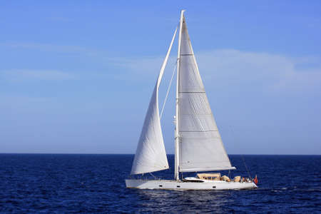 Sloop sailing in open waters photo