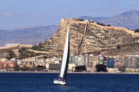 Sloop in Alicante Bay, Spain  photo