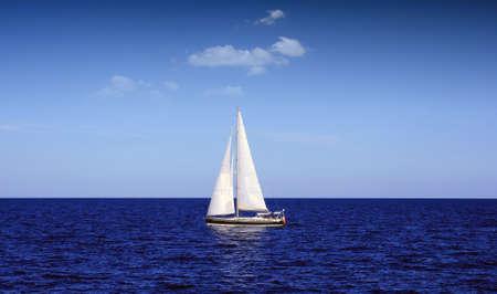 Sloop sailing in open waters photo