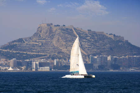 Catamaran in Alicante Bay, Spain  photo