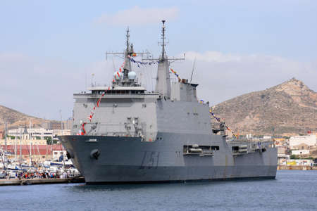 destroyer: Assault ship in port
