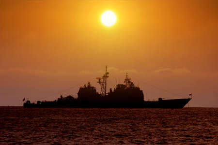 destroyer: USA destroyer anchored at the sunset