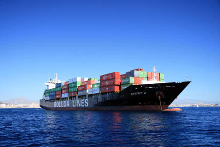 merchant: Container cargo anchored Editorial