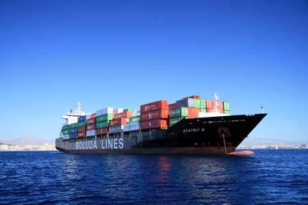 retailer: Container cargo anchored Editorial
