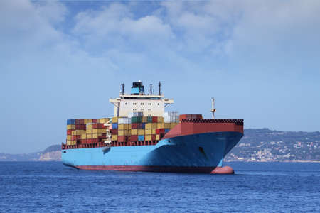 Container carrier merchant ship anchored photo