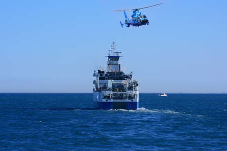 profundity: Helicopter and oceanographic ship Stock Photo
