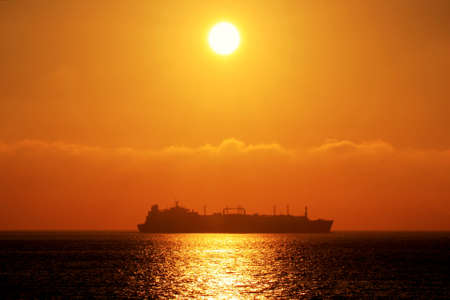 Container carrier merchant ship at sunset photo