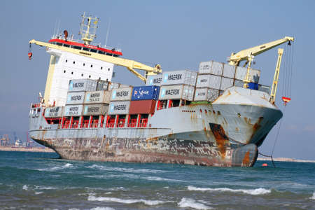 """VALENCIA, SPAIN - OCTOBER 01  The container ship """"CELIA"""" is aground on the El Saler Beach after the strong storm when the boat was anchored close to Valencia port, on october 01, 2012 in Valencia"""