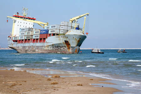 "VALENCIA, SPAIN - OCTOBER 01  The container ship ""CELIA"" is aground on the El Saler Beach after the strong storm when the boat was anchored close to Valencia port, on october 01, 2012 in Valencia  Stock Photo - 15625316"