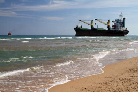 VALENCIA, SPAIN - OCTOBER 01  The container ship �BSLE SUNRISE� is aground on the El Saler Beach after the strong storm when the boat was anchored close to Valencia port, on october 01, 2012 in Valencia