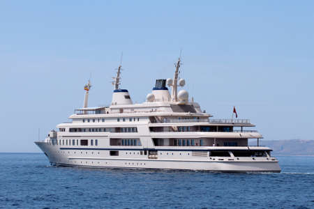 starboard: Luxury yacht leaving port