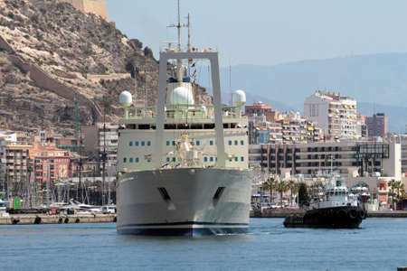 Merchant ship leaving port of Alicante photo