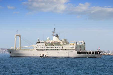containership: Merchant ship leaving port Stock Photo