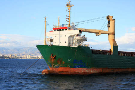 Old container ship transport anchored photo