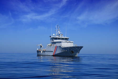 coastguard: French coastguard sailing in open waters  Stock Photo