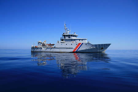 French coastguard sailing in open waters Stock Photo - 16847853