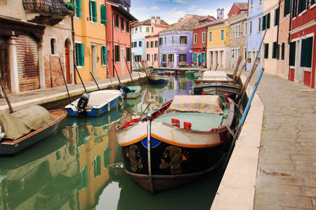 Colored houses and canals in Burano; Venice  photo