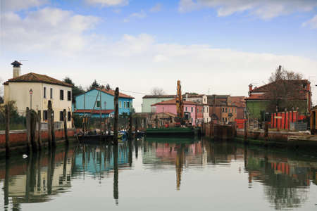 Colored houses and canals in Burano; Venice  Stock Photo - 17347400