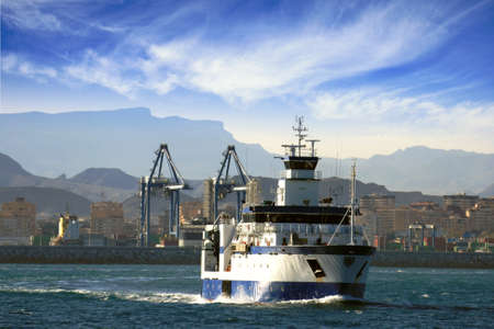 profundity: Fishing boat leaving the port of Alicante; Spain