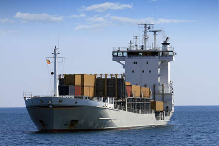 containership: Little containership anchored Stock Photo