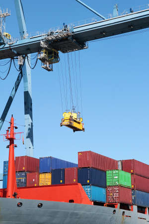 Container crane working with vessel photo