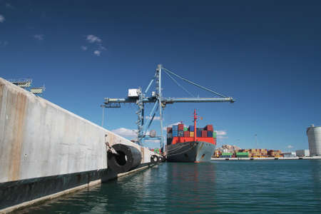 containership: Container ship docked and working with special crane