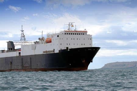 Cargo ship coming into port Stock Photo - 18563514