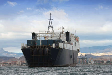 containership: Cargo ship in port  View of the stern