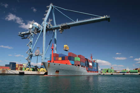 containership: Containers ship working with special crane Stock Photo