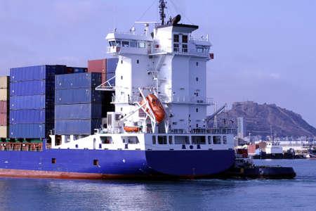 containership: Container ship entering in the por of Alicante Stock Photo