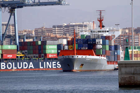 containership: Container ship leaving the port of Alicante