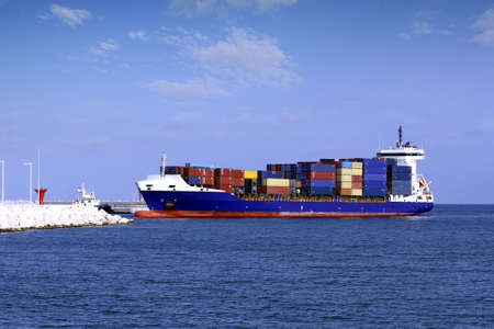 containership: Container ship entering port of Alicante