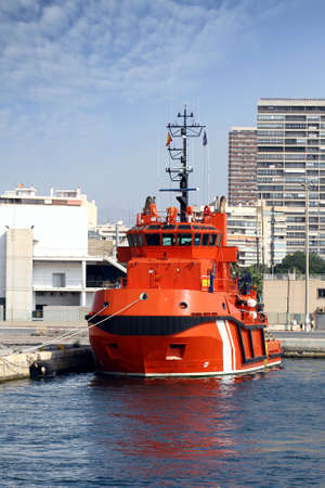 containership: Tug docked